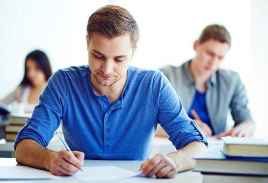 Serious student during written exam